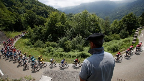 <p>               A spectator watches the pack as he rides during the fourteenth stage of the Tour de France cycling race over 117,5 kilometers (73 miles) with start in Tarbes and finish at the Tourmalet pass, France, Saturday, July 20, 2019. (AP Photo/ Christophe Ena)             </p>