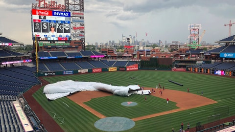 <p>               Members of the San Francisco Giants and Philadelphia Phillies join the grounds crew at Citizens Bank Park to help put the tarp on the field several hours before a scheduled baseball game in Philadelphia on Wednesday, July 31, 2019. A sudden burst of wind sent the tarp flapping, and players rushed in to help weigh it down. (AP Photo/Rob Maaddi)             </p>
