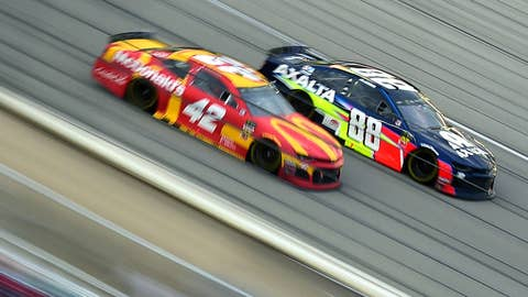 JOLIET, ILLINOIS - JUNE 30: Alex Bowman, driver of the #88 Axalta Chevrolet, races Kyle Larson, driver of the #42 McDonald's Chevrolet, during the Monster Energy NASCAR Cup Series Camping World 400 at Chicagoland Speedway on June 30, 2019 in Joliet, Illinois. (Photo by Jared C. Tilton/Getty Images)