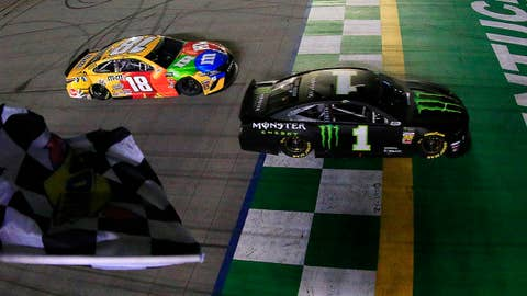 SPARTA, KENTUCKY - JULY 13: Kurt Busch, driver of the #1 Monster Energy Chevrolet, takes the checkered flag ahead of Kyle Busch, driver of the #18 M&M's Toyota Camry Toyota, to win the Monster Energy NASCAR Cup Series Quaker State 400 Presented by Walmart at Kentucky Speedway on July 13, 2019 in Sparta, Kentucky. (Photo by Daniel Shirey/Getty Images)