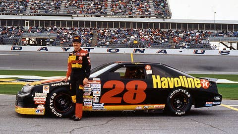 DAYTONA BEACH, FL Ð 1990s:  Davey Allison poses with the Robert Yates-owned Havoline Ford Thunderbird NASCAR Cup car at Daytona International Speedway in the early 1990s. (Photo by ISC Images & Archives via Getty Images)