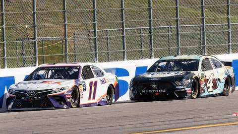 LOUDON, NH - JULY 21: Denny Hamlin driver of the #11 FedEx Express Toyota leads Kevin Harvick #4 down the back stretch during the Monster Energy NASCAR Cup Series, Foxwoods Resort Casino 301, on July 21, 2019, at New Hampshire Motor Speedway in Loudon, NH. (Photo by David Hahn/Icon Sportswire via Getty Images)