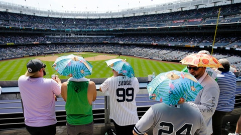 <p>               Fans use umbrella hats to protect themselves from the sun during the sixth inning of a baseball game between the New York Yankees and the Colorado Rockies Saturday, July 20, 2019, in New York. (AP Photo/Frank Franklin II)             </p>