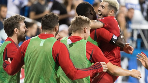 <p>               Toronto FC's Alejandro Pozuelo, right, celebrates with teammates after scoring during second-half MLS soccer match action against the Montreal Impact in Montreal, Saturday, July 13, 2019. (Graham Hughes/The Canadian Press via AP)             </p>