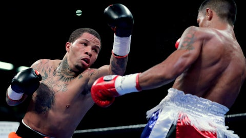 <p>               Gervonta Davis, left, throws a punch at Ricardo Nunez during the second round of their super featherweight boxing championship bout, Saturday, July 27, 2019, in Baltimore. (AP Photo/Julio Cortez)             </p>