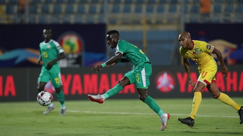<p>               Senegal's Idrissa Gana Gueye scores during the African Cup of Nations quarterfinal soccer match between Senegal and Benin in 30 June stadium in Cairo, Egypt, Wednesday, July 10, 2019. (AP Photo/Hassan Ammar)             </p>