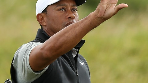 <p>               Tiger Woods of the United States catches a golf ball as he prepares to hit practice shots ahead of the start of the British Open golf championships at Royal Portrush in Northern Ireland, Tuesday, July 16, 2019. The British Open starts Thursday. (AP Photo/Jon Super)             </p>