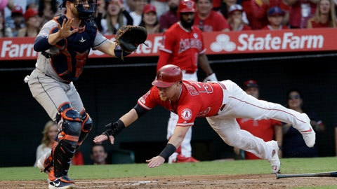 <p>               Los Angeles Angels' Kole Calhoun, right, scores past Houston Astros catcher Max Stassi on a three-run double by Albert Pujols during the first inning of a baseball game Tuesday, July 16, 2019, in Anaheim, Calif. (AP Photo/Marcio Jose Sanchez)             </p>