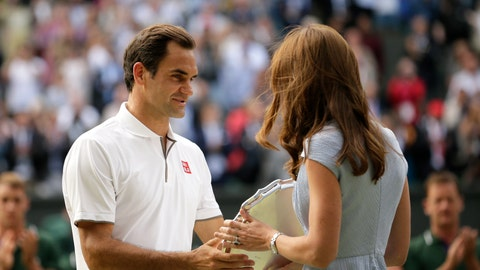 <p>               Switzerland's Roger Federer receives the runner up trophy from Kate, Duchess of Cambridge after losing to Serbia's Novak Djokovic in the men's singles final match of the Wimbledon Tennis Championships in London, Sunday, July 14, 2019. (AP Photo/Tim Ireland)             </p>