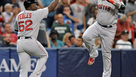<p>               Boston Red Sox third base coach Carlos Febles, left, congratulates pinch hitter Christian Vazquez after his solo home run off Tampa Bay Rays reliever Colin Poche during the seventh inning of a baseball game Tuesday, July 23, 2019, in St. Petersburg, Fla. (AP Photo/Steve Nesius)             </p>