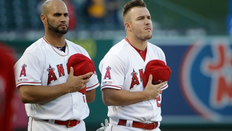 <p>               Los Angeles Angels' Albert Pujols, left, and Mike Trout listen to the national anthem before the team's baseball game against the Oakland Athletics on Friday, June 28, 2019, in Anaheim, Calif. (AP Photo/Marcio Jose Sanchez)             </p>
