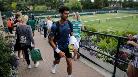 <p>               Serbia's Novak Djokovic leaves after playing a practice session ahead of the Wimbledon Tennis Championships in London Sunday, June 30, 2019. (AP Photo/Ben Curtis)             </p>