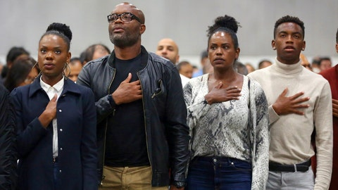 "<p>               Mixed martial arts great Anderson ""Spider"" Silva of Brazil, his daughter Kaory, 23, left, his wife Dayane and son Kalyl, 20, right, recite the Pledge of Allegiance after all but Dayane were sworn in as U.S. citizens in a mass naturalization ceremony Tuesday, July 23, 2019 at the Los Angeles Convention Center. (AP Photo/Reed Saxon)             </p>"