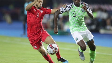 <p>               Nigeria's Jamilu Collins and Tunisia's Anice Badri fight for the ball during the African Cup of Nations third place soccer match between Nigeria and Tunisia in Al Salam stadium in Cairo, Egypt, Wednesday, July 17, 2019. (AP Photo/Hassan Ammar)             </p>