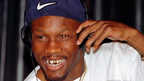 <p>               FILE - In this April 9, 1997, file photo, WBC welterweight champion Pernell Whitaker adjusts his head phones during a news conference in Las Vegas. Former boxing champion Pernell Whitaker has died after he was hit by a car in Virginia. He was 55. Police in Virginia Beach on Monday say Whitaker was a pedestrian when struck by the car Sunday night, July 14, 2019. The driver remained on the scene, where Whitaker was pronounced dead. (AP Photo/Lennox McLendon, File)             </p>