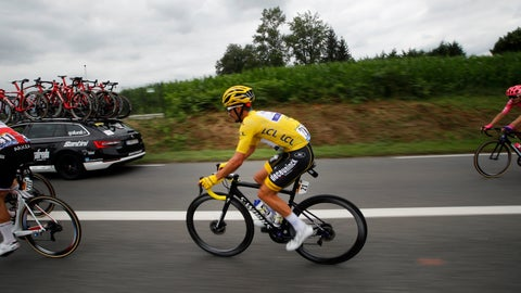 <p>               France's Julian Alaphilippe wearing the overall leader's yellow jersey rides with the pack during the fourteenth stage of the Tour de France cycling race over 117.5 kilometers (73 miles) with start in Tarbes and finish at the Tourmalet pass, France, Saturday, July 20, 2019. (AP Photo/ Christophe Ena)             </p>