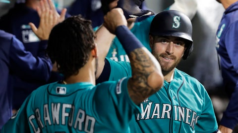 <p>               Seattle Mariners' Tom Murphy, right, is greeted by J.P. Crawford, left, after Murphy hit a game-tying two-run home run during the seventh inning of a baseball game against the Detroit Tigers, Friday, July 26, 2019, in Seattle. (AP Photo/Ted S. Warren)             </p>