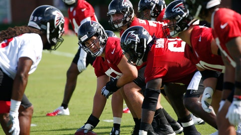 <p>               Atlanta Falcons center Alex Mack (51), second from left, prepares to run a play during their NFL training camp football practice Monday, July 22, 2019, in Flowery Branch, Ga.(AP Photo/John Bazemore)             </p>