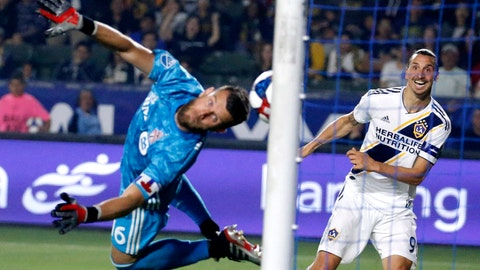 <p>               LA Galaxy forward Zlatan Ibrahimovic, right, scores on Toronto FC goalkeeper Quentin Westberg during the second half of an MLS soccer match in Carson, Calif., Thursday, July 4, 2019. The Galaxy won 2-0.(AP Photo/Ringo H.W. Chiu)             </p>