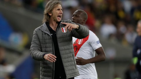 <p>               Peru's coach Ricardo Gareca gives instructions to his players during the final match of the Copa America against Brazil at the Maracana stadium in Rio de Janeiro, Brazil, Sunday, July 7, 2019. (AP Photo/Andre Penner)             </p>