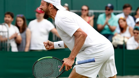 <p>               United States' Tennys Sandgren celebrates after beating Italy's Fabio Fognini in a Men's singles match during day six of the Wimbledon Tennis Championships in London, Saturday, July 6, 2019. (AP Photo/Alastair Grant)             </p>