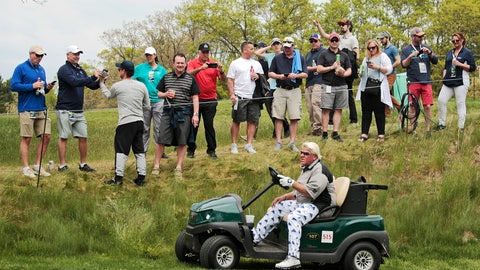 """<p>               FILE - In this May 17, 2019 file photo, John Daly drives his cart off the 16th tee during the second round of the PGA Championship golf tournament, at Bethpage Black in Farmingdale, N.Y. Organizers of the British Open have refused a request by former champion John Daly to use a golf cart at the championship in Royal Portrush this month. Daly had applied to use a cart because of his arthritic right knee. The R&A said it was declining the request because """"walking the course is an integral part of the championship and is central to the tradition of links golf."""" It said it was important to """"ensure that, as far as possible, the challenge is the same for all players in the field."""" (AP Photo/Andres Kudacki, FIle)             </p>"""