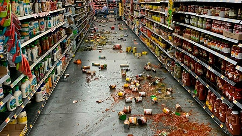 <p>               Food that fell from the shelves litters the floor of an aisle at a Walmart following an earthquake in Yucca Yalley, Calif., on Friday, July 5, 2019. (Chad Mayes via AP)             </p>