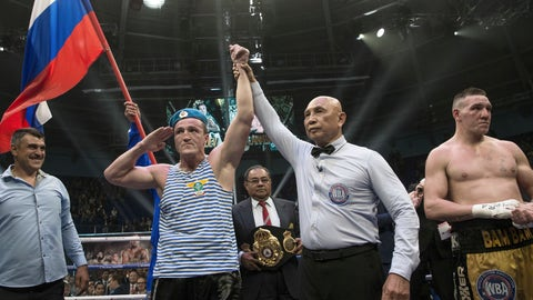 <p>               FILE - In this Sunday, July 9, 2017 file photo, Russian boxer Denis Lebedev, center left, celebrates his victory against Australian Mark Flanagan, right, after their cruiserweight WBA Super World title bout in Ekaterinburg, Russia. Former world cruiserweight boxing champion Denis Lebedev has retired aged 39 after a lengthy and colorful career, it was announced Thursday, July 11, 2019.(AP Photo/Anton Basanaev, File)             </p>
