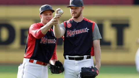 <p>               Sonny Gray, left, of the Cincinnati Reds, and Brandon Woodruff, of the Milwaukee Brewers, compare their baseball holds during batting practice for the MLB All-Star baseball game, Monday, July 8, 2019, in Cleveland. The game will be played Tuesday. (AP Photo/Tony Dejak)             </p>