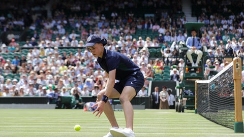 <p>               A ball boy picks up a ball in a Men's singles match between South Africa's Kevin Anderson and Argentina's Guido Pella during day five of the Wimbledon Tennis Championships in London, Friday, July 5, 2019. (AP Photo/Ben Curtis)             </p>