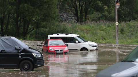 <p>               cars are trapped in a flooded street near the road of the nineteenth stage of the Tour de France cycling race over 126,5 kilometers (78,60 miles) with start in Saint Jean De Maurienne and finish in Tignes, France, Friday, July 26, 2019. Organizers stopped the world's premier cycling event Friday for the riders' safety when a sudden, violent storm made the route through the Alps too dangerous. (AP Photo/Thibault Camus)             </p>