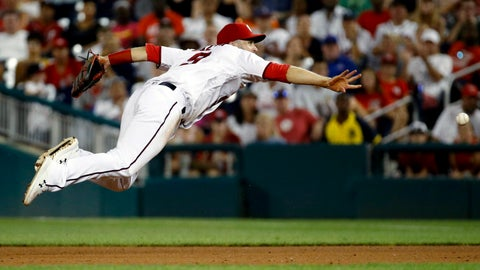 <p>               Washington Nationals second baseman Brian Dozier throws a ground ball single by Atlanta Braves' Josh Donaldson to first base in the sixth inning of a baseball game, Monday, July 29, 2019, in Washington. (AP Photo/Patrick Semansky)             </p>