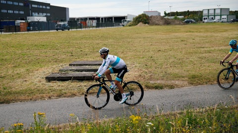 <p>               Kazakhstan's Alexey Lutsenko rides with teammates during a training session, in Brussels, Friday, July 5, 2019, ahead of upcoming Saturday's start of the race. (AP Photo/Christophe Ena)             </p>