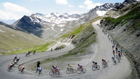 <p>               FILE - In this July 17, 2007 file photo, the pack speeds down the Iseran pass, during the 9th stage of the 94th Tour de France cycling race between Val d'Isere and Briancon, French Alps. With seven mountain stages and five summit finishes, including three above 2,000 meters, this year's Tour de France is the highest in the history of the race. (AP Photo/Bas Czerwinski, file)             </p>
