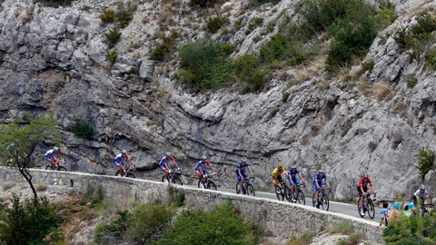 <p>               The pack with France's Julian Alaphilippe wearing the overall leader's yellow jersey rides during the seventeenth stage of the Tour de France cycling race over 200 kilometers (124,27 miles) with start in Pont Du Gard and finish in Gap, France, Wednesday, July 24, 2019. (AP Photo/Thibault Camus)             </p>