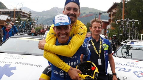 <p>               France's Julian Alaphilippe, wearing the yellow jersey jokes with Spain's Enric Mas during the nineteenth stage of the Tour de France cycling race in Val d'Isere, France, Friday, July 26, 2019. Organizers stopped the world's premier cycling event Friday for the riders' safety when a sudden, violent storm made the route through the Alps too dangerous. (AP Photo/Thibault Camus)             </p>