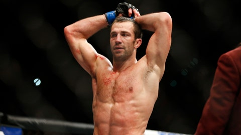 <p>               FILE - In this Dec. 12, 2015, file photo, Luke Rockhold rests between rounds as he fights Chris Weidman in a middleweight championship mixed martial arts bout at UFC 194 in Las Vegas. Rockhold landed a Ralph Lauren modeling contract during his 17-month absence from the UFC. However, he still couldn't resist returning to his face-damaging first love, and he sees a path to a quick championship at light heavyweight when he faces Poland's Jan Blachowicz at UFC 239 on Saturday, July 6, 2019. (AP Photo/John Locher, File)             </p>