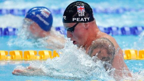 <p>               Britain's Adam Peaty swims in his heat of the men's 100m breaststroke at the World Swimming Championships in Gwangju, South Korea, Sunday, July 21, 2019. (AP Photo/Lee Jin-man)             </p>