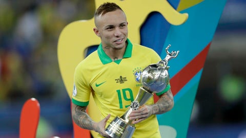 <p>               Brazil's Everton holds his top scorer trophy after his team's 3-1 defeat of Peru in the final match of the Copa America at Maracana stadium in Rio de Janeiro, Brazil, Sunday, July 7, 2019. (AP Photo/Silvia Izquierdo)             </p>