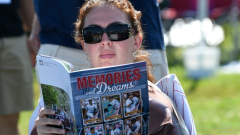 <p>               Roy Halladay fan Jacqueline Sarricchio of Bellmar, N.J., reads a program while waiting for the start of the National Baseball Hall of Fame induction ceremony at the Clark Sports Center on Sunday, July 21, 2019, in Cooperstown, N.Y. (AP Photo/Hans Pennink)             </p>
