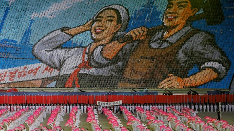 """<p>               In this Tuesday, July 16, 2019, photo, North Koreans hold cards to make an image depicting a worker and a farmer during a mass game performance of """"The Land of the People"""" at the May Day Stadium in Pyongyang, North Korea. (AP Photo/Vincent Yu)             </p>"""