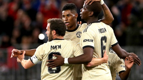 <p>               Manchester United's Marcus Rashford, centre, is congratulated by teammates Juan Mata, left, and Paul Pogba after scoring a goal against the Perth Glory during their friendly soccer match in Perth, Australia, Saturday, July 13, 2019. (Richard Wainwright/AAP Image via AP)             </p>