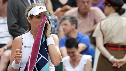 <p>               Britain's Johanna Konta wipes her face during a break of a women's quarterfinal match against Czech Republic's Barbora Strycova on day eight of the Wimbledon Tennis Championships in London, Tuesday, July 9, 2019. (AP Photo/Kirsty Wigglesworth)             </p>