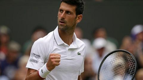 <p>               Serbia's Novak Djokovic celebrates winning the second set against Belgium's David Goffin during a men's quarterfinal match on day nine of the Wimbledon Tennis Championships in London, Wednesday, July 10, 2019. (AP Photo/Tim Ireland)             </p>