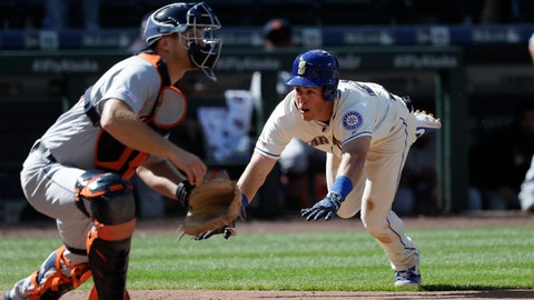 <p>               Seattle Mariners' Dylan Moore, right, dives safely for home to score the winning run as Detroit Tigers catcher John Hicks waits for the ball in the 10th inning of a baseball game Sunday, July 28, 2019, in Seattle. (AP Photo/Elaine Thompson)             </p>