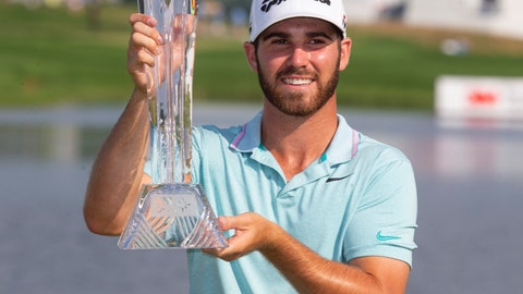 <p>               Matthew Wolff holds the trophy after winning the 3M Open golf tournament Sunday, July 7, 2019, in Blaine, Minn. (AP Photo/Andy Clayton- King)             </p>