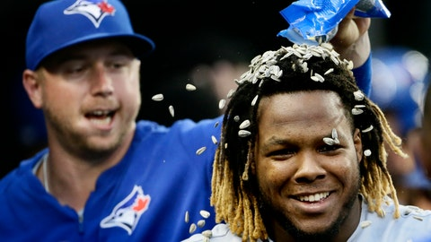 <p>               Toronto Blue Jays' Vladimir Guerrero Jr. gets sunflowers seeds dumped on his head by Justin Smoak, left, after hitting a grand slam against the Detroit Tigers during the fifth inning of a baseball game, Saturday, July 20, 2019, in Detroit. (AP Photo/Duane Burleson)             </p>