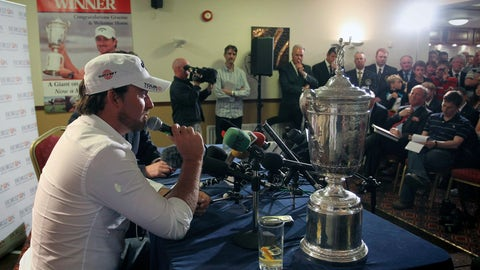 <p>               FILE - In this Wednesday, June, 23, 2010, file photo, U.S. Open golf champion Graeme McDowell receives a warm welcome from members of Rathmore Golf Club, in Portrush, Northern Ireland. McDowell was among three major champions from Northern Ireland that sparked interest in the British Open returning to Royal Portrush for the first time since 1951. (AP Photo/Peter Morrison, File)             </p>