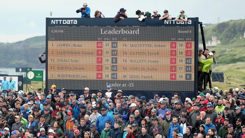 <p>               Spectators clamber on to and on top of a scoreboard as they vie to get a glimpse of Ireland's Shane Lowry and England's Tommy Fleetwood as they play during the final round of the British Open Golf Championships at Royal Portrush in Northern Ireland, Sunday, July 21, 2019. (AP Photo/Peter Morrison)             </p>