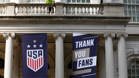 <p>               A worker hangs signs at City Hall one day ahead of a ticker-tape parade for the U.S. Women's World Cup winning team, Tuesday, July 9, 2019, in New York. (AP Photo/Kathy Willens)             </p>